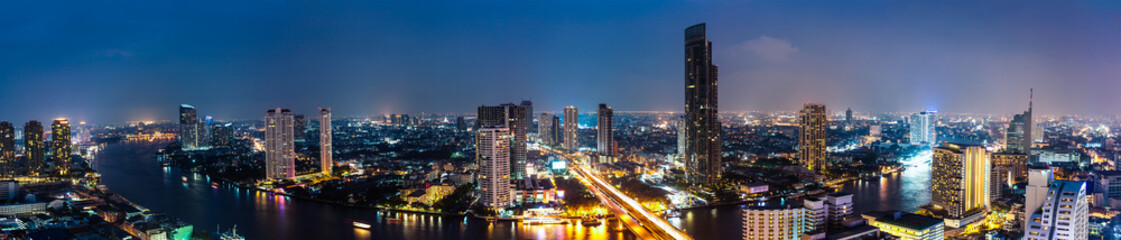 Business Building Bangkok city area at night life with transport