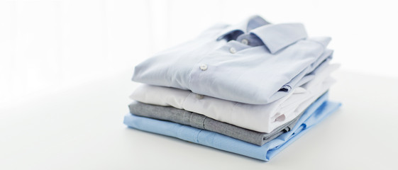 close up of ironed and folded shirts on table
