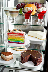 Fridge with fruit cake and desserts