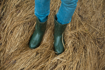 Man feet in rubber boots