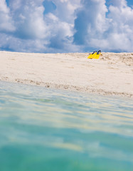 Yellow flippers for swimming on the beach, Maldivian island