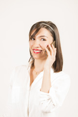 Young woman talking on the mobile phone smiling