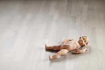 broken doll on the floor