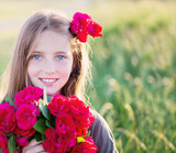 Portrait of a beautiful girl with red roses