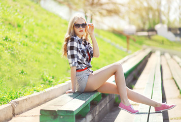 Fashion glamour pretty blonde outdoors in sunny summer day