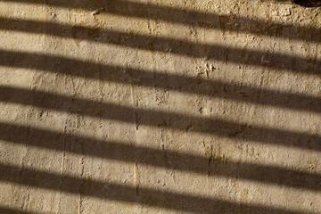 Texture di pietra leccese con ombre parallele