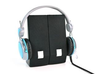 Headphones and speaker on white background