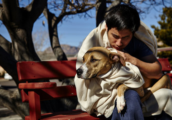 Homeless Man with Dog on Bench
