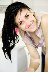 Happy young woman with wet hair smiling looking camera