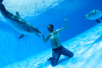 Men and two dolphin