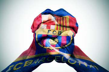 man hands patterned with the flag of the Futbol Club Barcelona