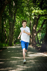 Teenage boy running in park