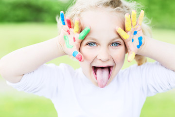 young girl with colourful hands