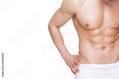 Fit muscular man in towel, isolated on white background Poster