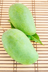 green mango on a wooden background
