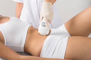 Woman Receiving Laser Treatment On Belly