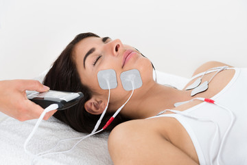 Therapist Giving Electrodes Therapy