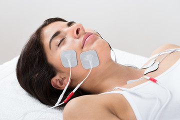 Woman With Electrodes On Her Face