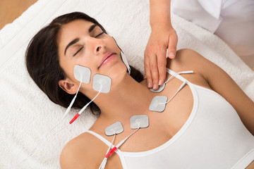Woman Having Electrodes Therapy