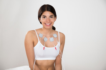 Happy Woman With Electrodes On Her Chest