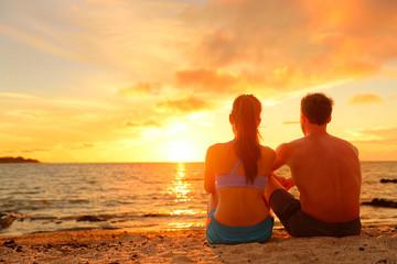 Happy Romantic Couple Enjoying Sunset at Beach