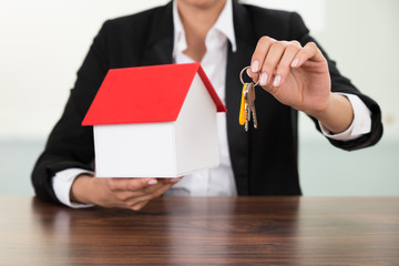 Businesswoman Holding House Model And Keys