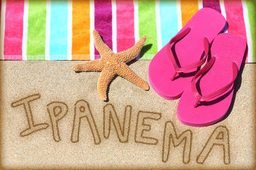 Ipanema beach vacation concept - sand and towel