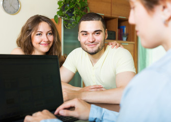 Couple discussing details of  insurance