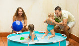 Family having fun in kids pool