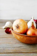 Whole onions in rustic bowl