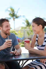 Cafe couple having fun drinking coffee talking