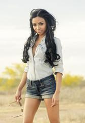 Beautiful woman denim shorts top
