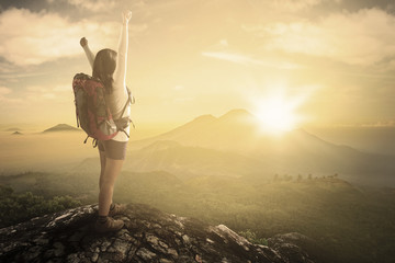Female backpacker enjoying freedom at mountain