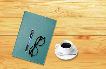 Notebook with office supplies with pen with glasses and cup of c