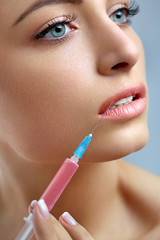Beautiful Woman Gets Lips Injections. Cosmetology. Beauty Face