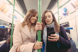 Two women commuting with tube in London.
