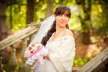 A beautiful bride looking at the camera outdoors