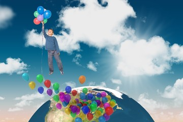 Composite image of cute boy holding balloons
