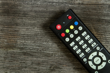 TV remote control on wood