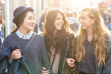 Multiracial group of girls walking in London