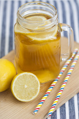 Lemon tea  in a mason jar with straws.