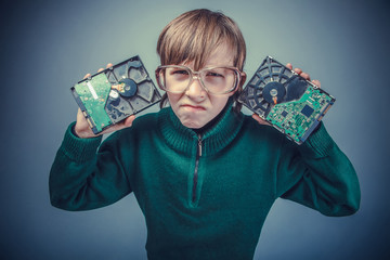 European-looking boy of ten years in glasses  holding a hard  dr