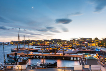 Oslo harbour with boats and yachts at twilight.