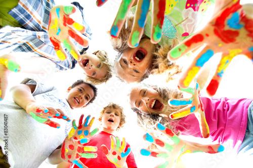 Fototapeta smiling kids with colourfull hands