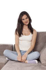 Beautiful young woman posing on a couch