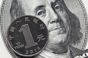 One chinese coin yuan and one hundred dollar bill
