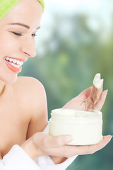 Spa woman with body lotion.