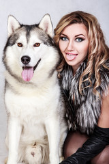 Beautiful young woman with a husky dog