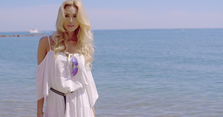Blond Woman in White Sun Dress Standing on Beach