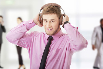 Young businessman listening to music.